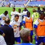 Latics players returning from a pre-match warmup