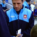Zola signing a programme