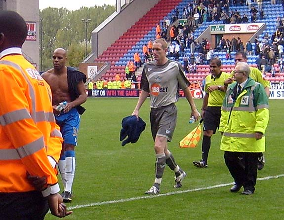 Chris Kirkland and Marlon King leave the field