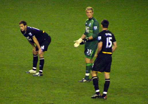 Joe Hart has a word with his team mates at half time