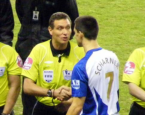 Scharner shakes hands with the ref