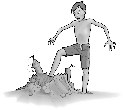 Boy kicking sand castle