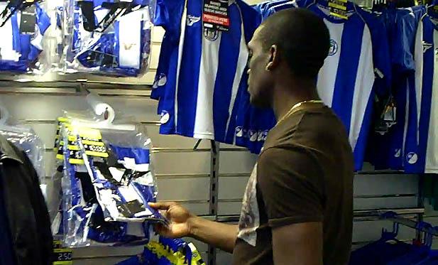 Hendry Thomas at the club shop