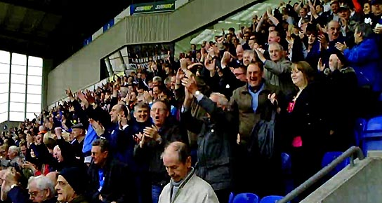 Wigan fans celebrate beating Arsenal