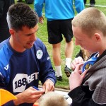 Scharner signs an autograph