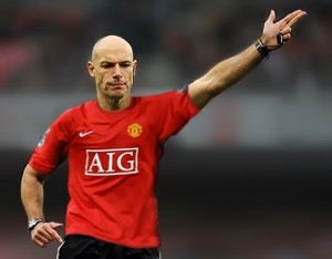 Howard Webb in a Manchester United Shirt