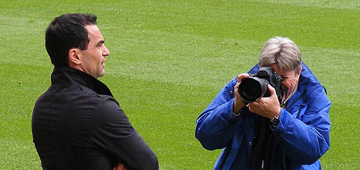 Roberto Martinez is snapped by a photographer