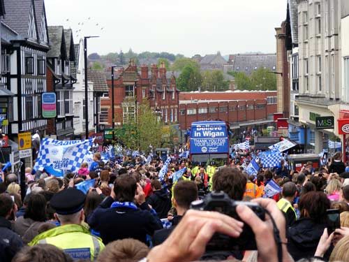 The Latics parade bus rolls into town